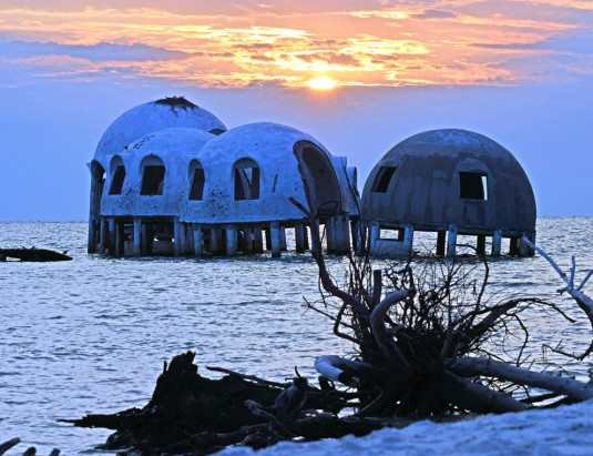 Disappearing Domes at Sunset. Sunset spotlights the beauty of these disappearing dome houses that are slipping slowly into the ocean. Cape Romano, Marco Island, Naples, Florida—Michele Cole