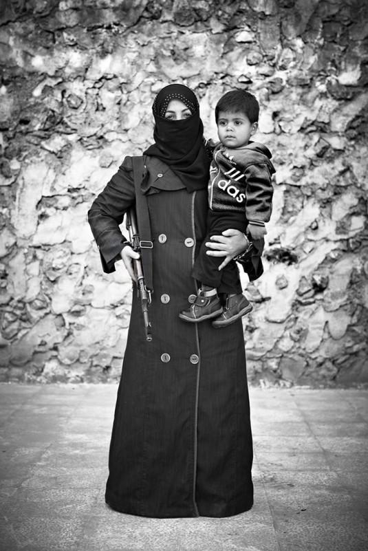 Female fighter in Syria_Sebastiano Tomado_Rex