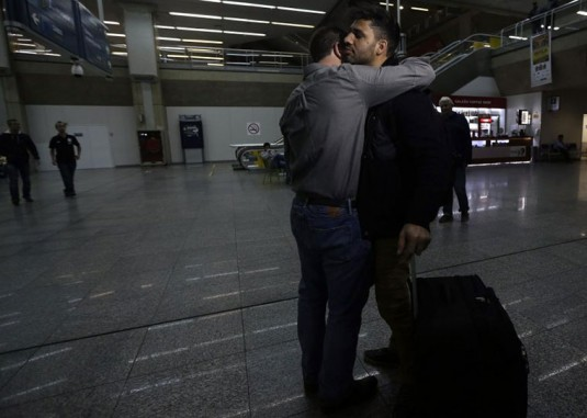 Glenn Greenwald hugs his partner David Miranda as he returns to Brazil after being detained by UK authorities_Ricardo Moraes_Reuters