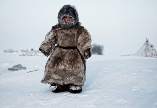 Living on the Tundra. A young Nenet boy in Siberia plays in -30 degrees—Simon Morris
